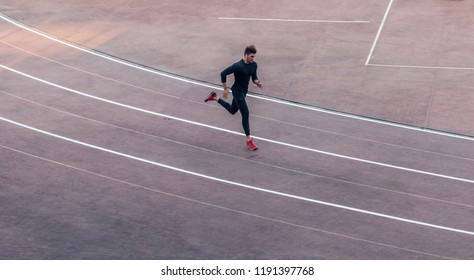 Top view of runner jogging on race track