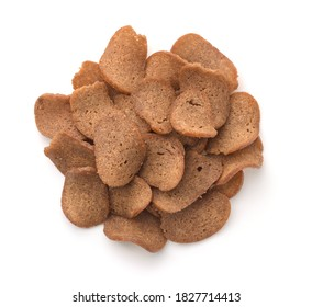 Top view of rye bread chips isolated on white