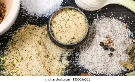 top view of salt cellar and various Seasoned Salts with ingredients on dark wooden table