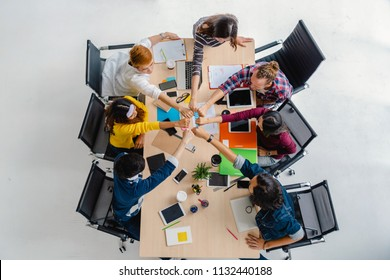 Top view scene of Asian and Multiethnic Business people with casual suit sitting and Hand coordination with happy action for teamwork in the modern workplace, people business group concept