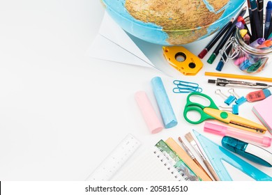 Top view of school accessories on a desk with copy space
