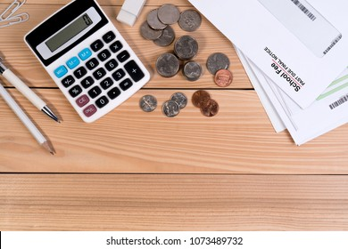 Top view, School fee past due final notice letter, education fee, calculator, money coin, pen and pencil on wooden table. School due date concept.