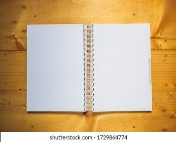 Top view, School notebook on wooden background, Notebook on a table