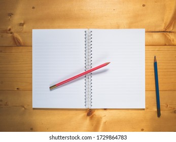 Top view, School notebook on wooden background, Notebookand color pencil on a table