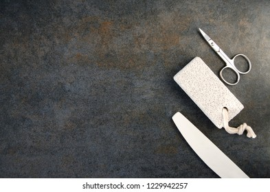 Top view of scissors, nail file and pumice