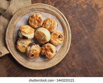 Top view of scones with chocolate chip on wood background