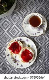 Top view of scones, jam and tea.