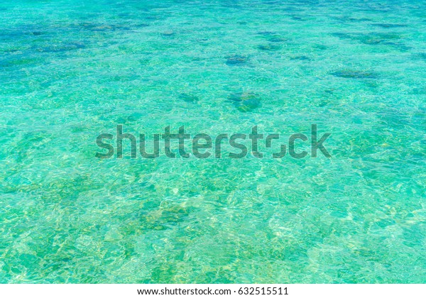 Top view of the sea with the coral reefs at Maldives island