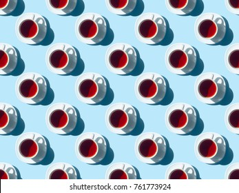 top view of seamless pattern with healthy herbal tea in cups on blue