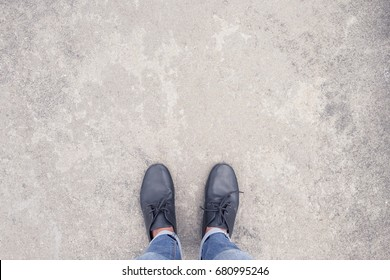top view selfie of fashion jeans and leather shoes on concrete background