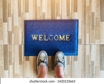 Top view of selfie feet on welcome map, on wooden floor background , decision making , Choices concept, where to go, directions, business solutions