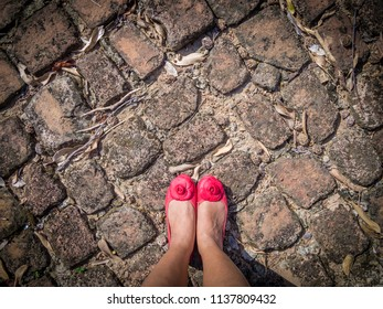 Top view of selfie feet of red shoe on old brick floor background, Choices concept, where to go, directions, business solutions, travel ,fasion