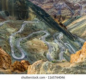 Top view of a serpentine road near Lamayuru - Tibet, Kargil District, Leh district, Western Ladakh, Himalayas, Jammu and Kashmir, Northern India