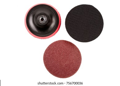 Top view of Set Circular sandpaper discs and plastic bracket handle with velcro Tape Strips for grinding machine isolated on white background.