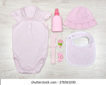 top view set of fashion trendy clothes and kids stuff in pink color for little  baby girl, fashion concept