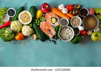 Top view set healthy food for cooking healthy and diet food (cereals, seeds, fish, vegetables and fruits) on stone surface with copy space. Healthy food or diet eating concept