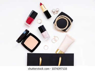 Top view set of woman accessory and cosmetic makeup in gift bag. Fashion essentials flat lay