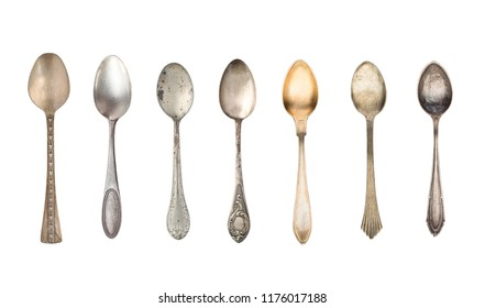 Top view of seven old silver beautiful tea spoons isolated on white background