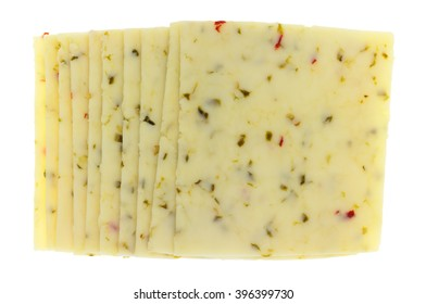 Top view of several slices of pepper jack cheese isolated on a white background.