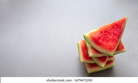 The top view of the shell of the watermelon is stacked together with a light gray backdrop, with space for the text.