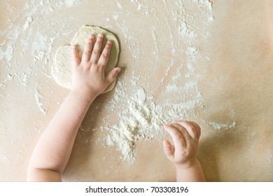 Top view shoot of children's hands make dough on the table. Learning in kindergarten