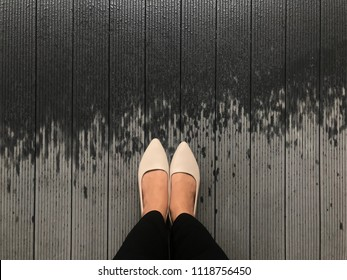 Top view shot everyday look of women wear basic long black trousers and classic beige flat shoes. (Shoe selfie concept)