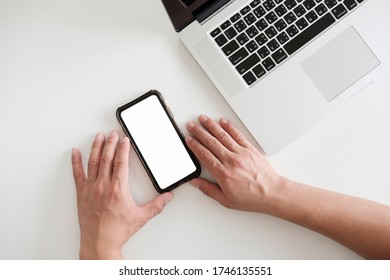 Top view shot of a man's hands using smartphone with white screen, Cropped shot
