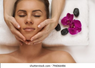 Top view shot of a young beautiful woman receiving face massage by a professional spa therapist at the luxurious resort copyspace hotel treatment anti-aging soothing recreation pampering skincare