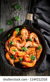 Top view of shrimps on pan with garlic and peppers