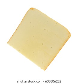 Top view of a single slice of muenster cheese isolated on a white background.