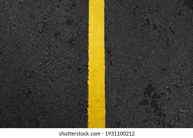 Top view of single yellow road line on the asphalt road to apart the lane for car driving