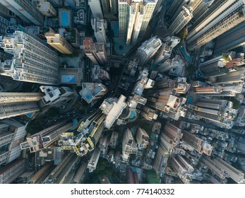Top View of Skyscrapers in a Big City,Aerial view flying by drone of a Hong Kong City with  development buildings, transportation, energy power infrastructure. Financial and business centers in asian,