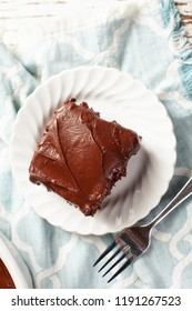 Top view  of a slice of Dark Chocolate Buttercream Frosting on a moist and delicious chocolate cake