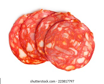 top view of sliced chorizo salami on white background