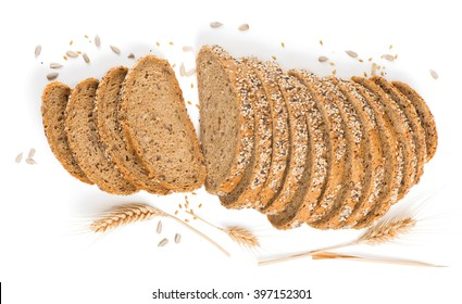 Top view of sliced homemade brown bread with cereals. Isolated over white background.