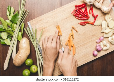 Top view of sliced vegetables on wooden cutting boards.