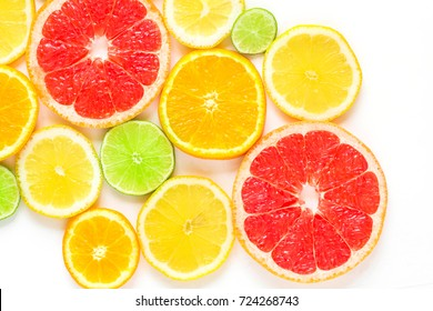 top view of slices of citrus fruits isolated on white background.