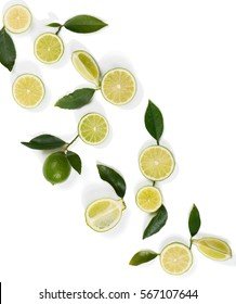 Top view of slices, whole of lime fruits and leaves isolated on white background.