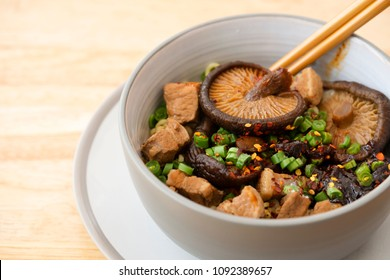 Top view of Slow cooked pork spare noodles with shiitake Mushroom and mixed vegetables or Braised pork noodle soup, Thai, Chinese and Taiwanese cuisine