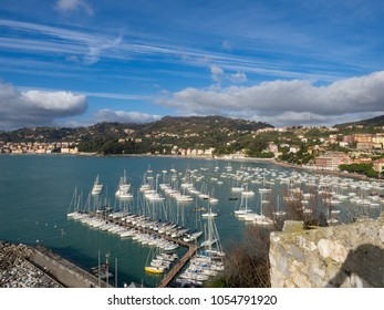 Top view of small city Lerici on Ligurian coast, Italy, in province of La Spezia. Panoramic view of Italian town Lerici. A lot of boat in harbor and city beach. Sunny day. January, 2018