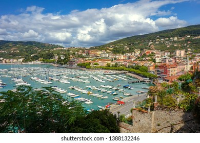 Top view of small city Lerici on Ligurian coast, Italy, in province of La Spezia. Panoramic view of Italian town Lerici. A lot of boat in harbor and city beach. Sunny day.