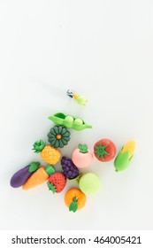 Top view, Small figure of fruit shop owner with fruits on white background.