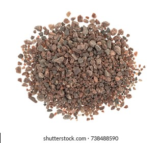 Top view of a small pile of Himalayan black salt isolated on a white background.