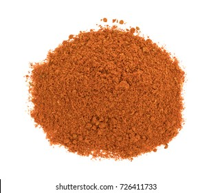 Top view of a small pile of taco seasoning isolated on a white background.