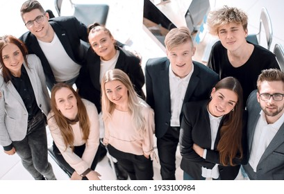 top view. smiling young business team looking at the camera