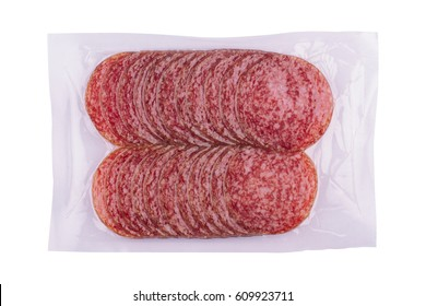 top view of smoked salami sausages slices in transparent vacuum plastic packaging isolated on white background