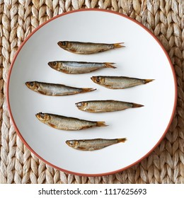 top view of smoked sprats, known as Kieler Sprotten in Germany, arranged on plate