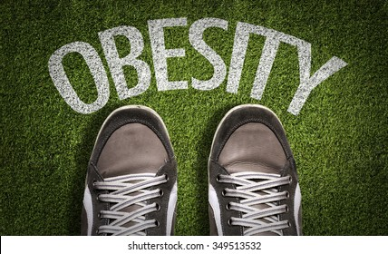 Top View of Sneakers on the grass with the text: Obesity