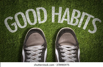 Top View of Sneakers on the grass with the text: Good Habits
