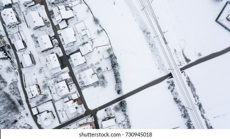 Top view of snow covered buildings.